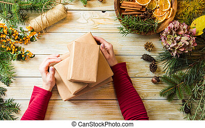 The girl creates Christmas presents of eco style