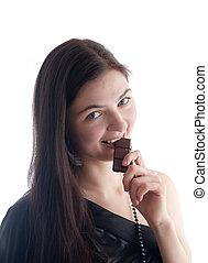The girl eats chocolate