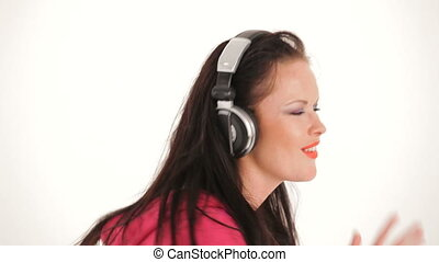 The girl fervently dances and listens to music on headphones.