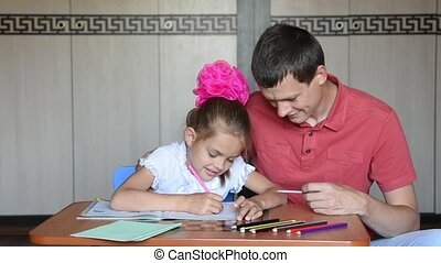 The girl first grader counts on her fingers performing using...
