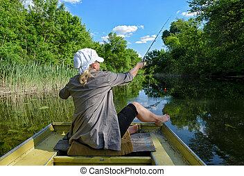 The girl fishing in the lake
