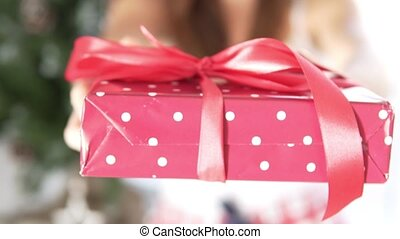 The girl gave a beautifully packaged Christmas gift