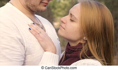 The girl gently laid her hands on the broad chest of the man...
