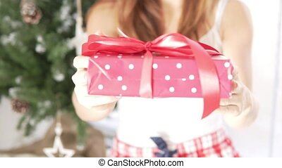 The girl gives a beautifully wrapped gift