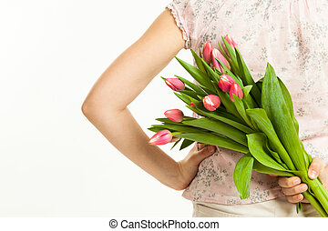 the girl holds a bouquet of tulips