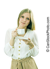 The girl holds a cup with hot drink