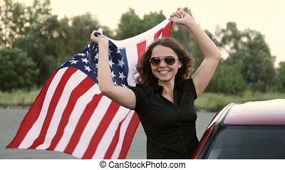The girl holds the banner of America - Happy girl with an...