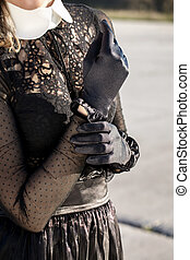 The girl in a black gloves