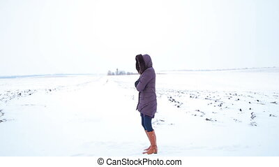 The girl in a field. snowy winter