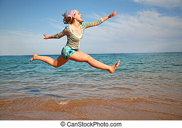 The girl in a jump about the sea