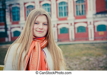 The girl in a orange scarf