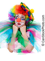 The girl in a suit of the clown isolated on a white background