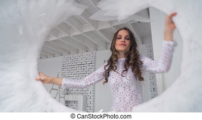 The girl in a white dress waving white wings