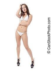 The girl in bikini isolated on white background