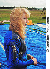 The girl in blue overalls on airfield