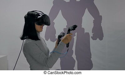 The girl in glasses of a virtual reality.