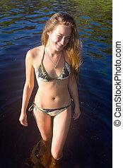 The girl in lake water