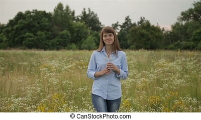 The girl in the meadow with wildflowers