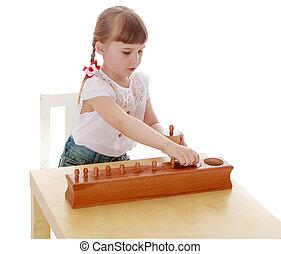 The girl in the Montessori environment