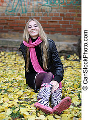The girl in the pink scarf and boots