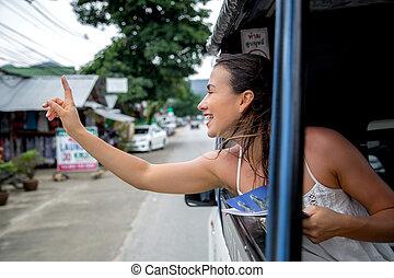 the girl in the taxi tuk-Tuk