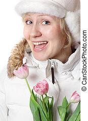 The girl in winter clothes with pink tulips
