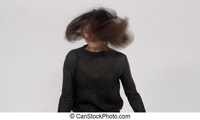 The girl is dancing in the studio