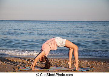 the girl is engaged in fitness and yoga