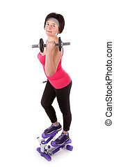 The girl is engaged in fitness with dumbbells on stepper. On a white background.