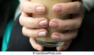 girl is holding a cup of coffee