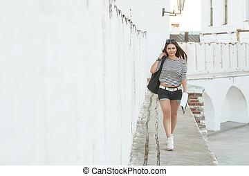The girl is on the bridge