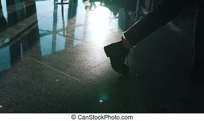 the girl is on the floor in the terminal