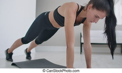 arm raising in a pose of plank - the girl is performinfarm ...