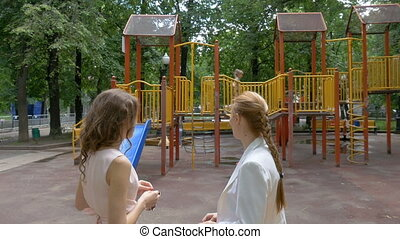 The girl is playing in the playground.
