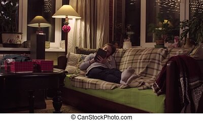 The girl is reading an e-book.