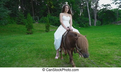 the girl is riding a pony