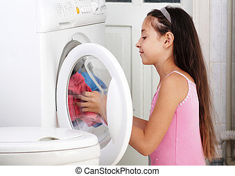 The girl is washing clothes