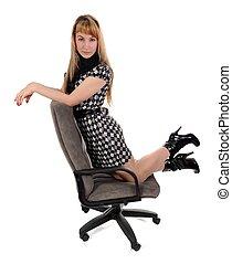 The girl kneeling in office armchair