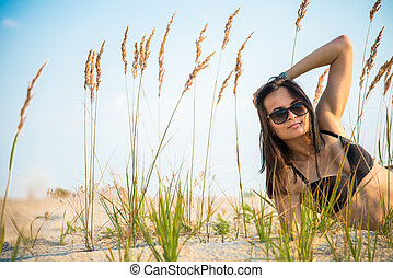 The girl lies on a background of wheat ears