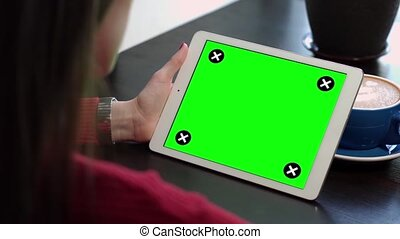 The Girl looks at the Green Screen of the Gadget