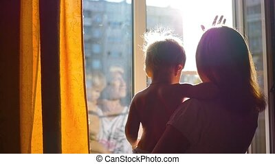 the girl looks into the open window