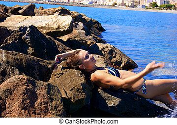 The girl lying on a stone