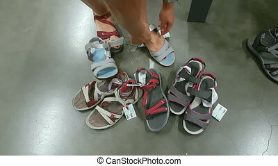 The girl measures shoes
