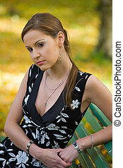 The girl on a bench in park