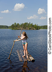 The girl on small wooden raft