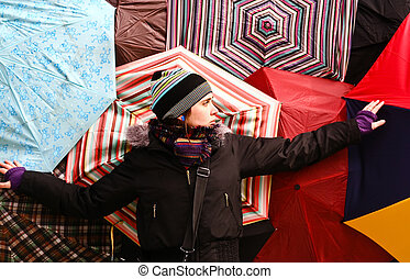 The girl on the background of colorful umbrellas