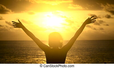 The girl on the beach to enjoy the sunset on the island of...