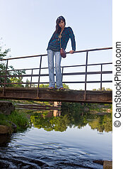 The girl on the old bridge