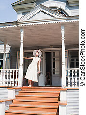 The girl on the porch of the old manor