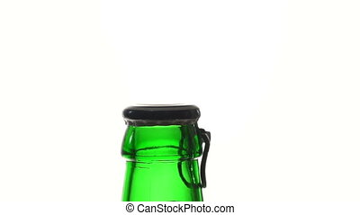 The girl opens a beer bottle. Silhouette of a hand and a...